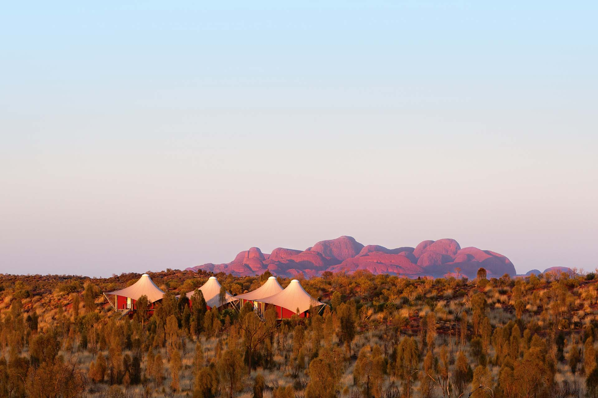Longitude 131 is an upmarket tourism resort in central australia close to Ayers Rock or Uluru and KataJuta NP red centre Uluru NT. tents and kata juta at sunrise
